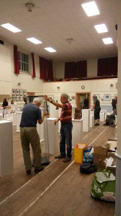 Setting up exhibition at Grasmere Village Hall