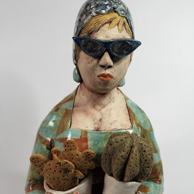 White Stoneware Figure of a Woman holding Cacti