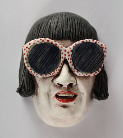 Porcelain Wall Hanging Woman wearing sunglasses