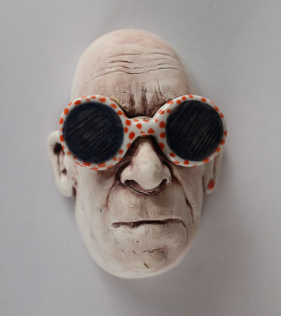 Porcelain Wall Hanging Man wearing sunglasses