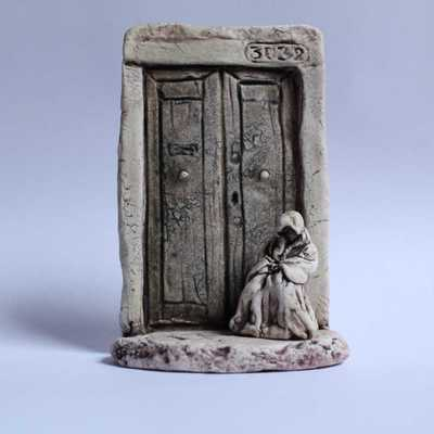 Porcelain Wall Hanging Hooded Figure in Doorway